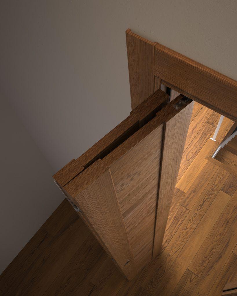 Porta a libro in legno con maniglia salvaspazio