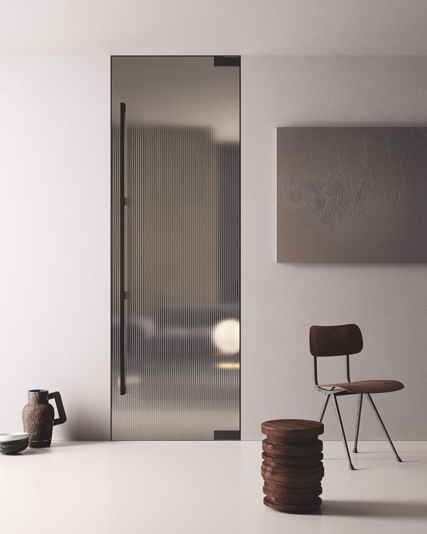 Porta raso parete a bilico con vetro e maniglione - Gidea